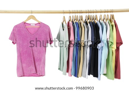 Rainbow colors. casual shirts on wooden hangers, - stock photo
