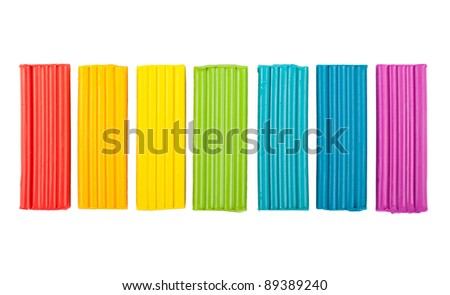 Rainbow colors plasticine isolated on white background - stock photo