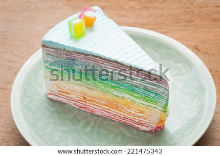 Rainbow crape cake on plate. (Selective Focus) - stock photo