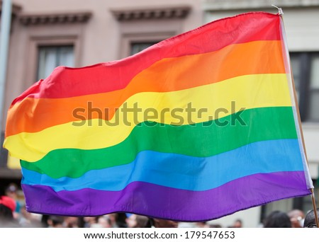 Rainbow Flag on the Pride Parade. - stock photo