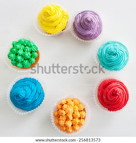 Rainbow Happy Birthday cupcakes on the white background with copy space - stock photo