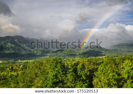 rainbow in jungle Buddist temple Borobudur complex in Yogjakarta in Java, indonesia - stock photo