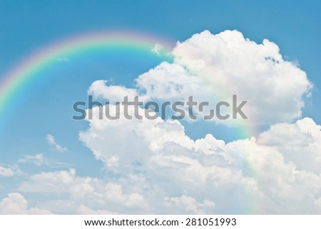 rainbow in the blue sky after the rain - stock photo