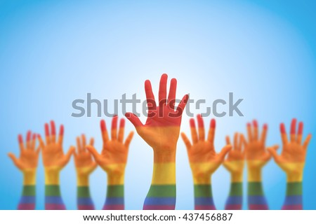 Rainbow multi-color flag pattern on blur many people human hands raising upward isolated on blue vintage background+clipping path: LGBT equal rights movement: Equality concept campaign conceptual idea - stock photo