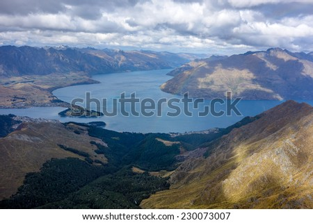 Rainbow on Wakatipu Lake from Ben Lomond track Queenstown New Zealand - stock photo