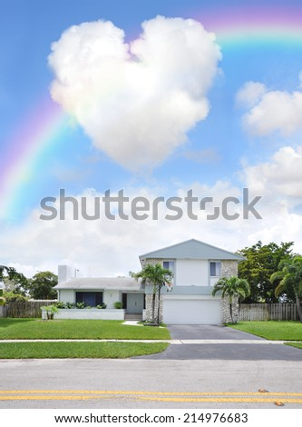 Rainbow over Suburban Back Split Style home in residential neighborhood USA Blue Sky Clouds - stock photo