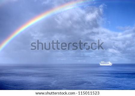 Rainbow over the ocean. - stock photo