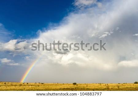 Rainbow over the plains in Texas, USA - stock photo
