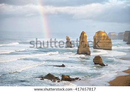 Rainbow over the Twelve Apostles, The great ocean road, Victoria,Australia - stock photo