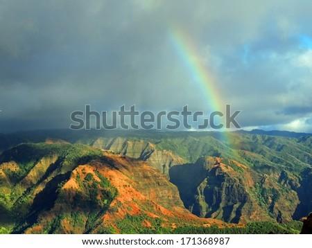 rainbow over waimea canyon  in kauai, hawaii   - stock photo