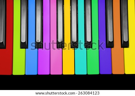 Rainbow piano keys, isolated on a white background  - stock photo