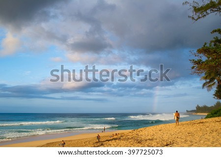 Rainbow scenic view over the ocean at popular surfing place Banzai Pipeline Beach, Oahu North Shore  - stock photo
