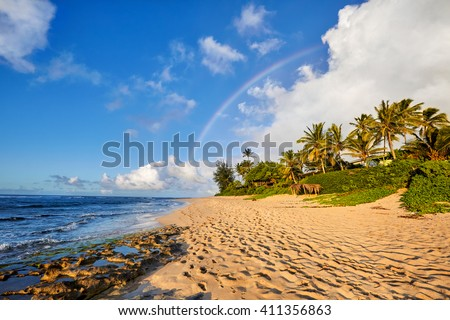 rainbow scenic view over the popular surfing place Sunset Beach, North Shore, Oahu, Hawaii, USA - stock photo