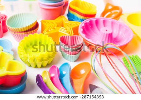 Rainbow silicone confectionery utensils on a white background - stock photo