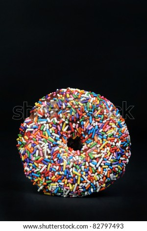 Rainbow Sprinkle Doughnut with Lots of Room For Your Type. - stock photo