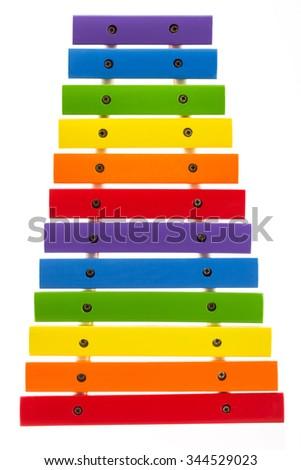 Rainbow toy xylophone isolated on white background - stock photo
