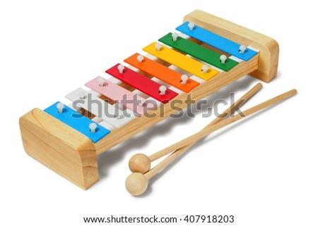 Rainbow xylophone on white background - stock photo