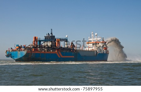Rainbowing dredger - stock photo