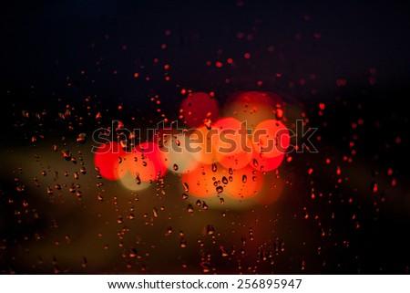 Raindrops and traffic lights  - stock photo