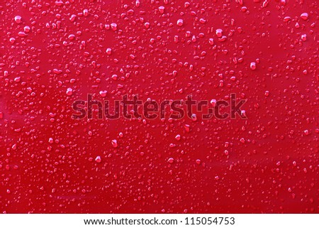 Raindrops on a red background - stock photo