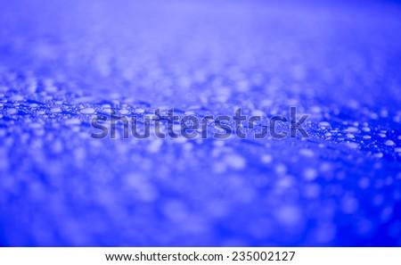 Raindrops on blue surface metal  - stock photo