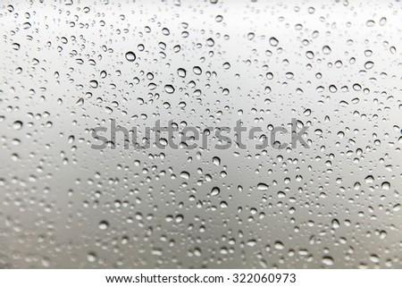 raindrops on glass background - stock photo