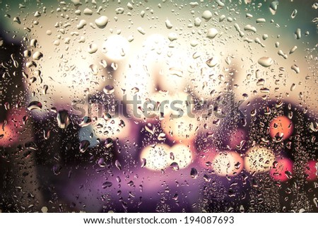 raindrops on glass. Outside the window the evening street - stock photo