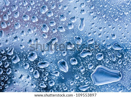 raindrops on glass pane - stock photo