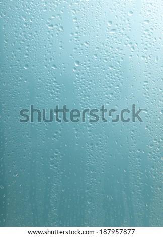 raindrops on glass window - stock photo