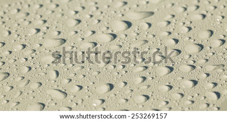 Raindrops on gray metal surface - stock photo