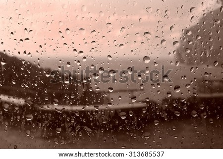 Raindrops on the glass in autumn - stock photo