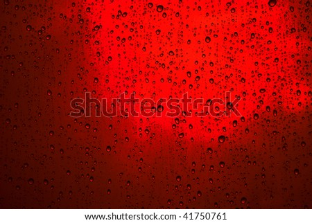 Raindrops on the glass window like bubbles in the water. - stock photo