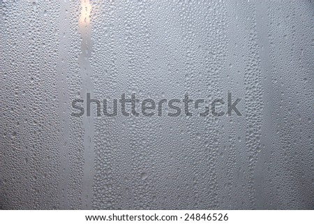Raindrops on the window glass (as an abstract background) - stock photo