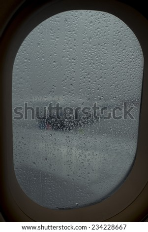 Raindrops on the window of the plane - stock photo