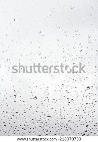 raindrops on window glass - stock photo