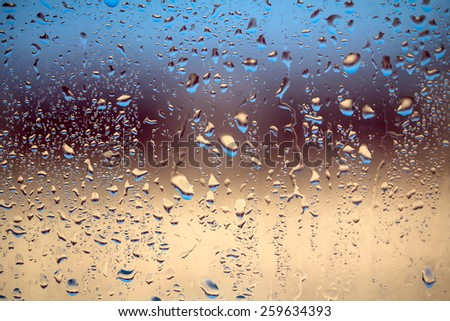 raindrops on window glass, background - stock photo