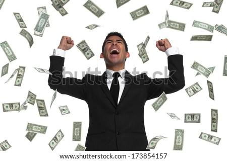 Raining money on a celebrating businessman - stock photo