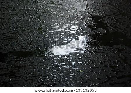 Raining on new asphalt - stock photo
