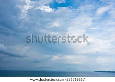 rainy cloudy sky over sea - stock photo