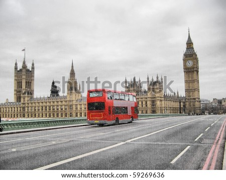 Rainy day at the Houses of Parliament with red bus, London, UK - stock photo