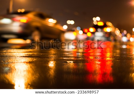Rainy day in the city at night, traffic jam on the street - stock photo