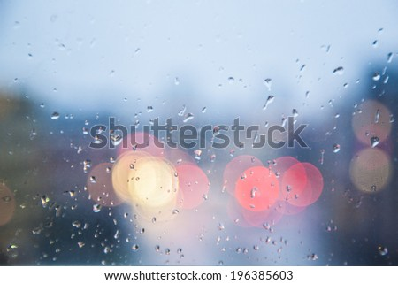 Rainy days,Rain drops on window,rainy weather,rain and bokeh - stock photo