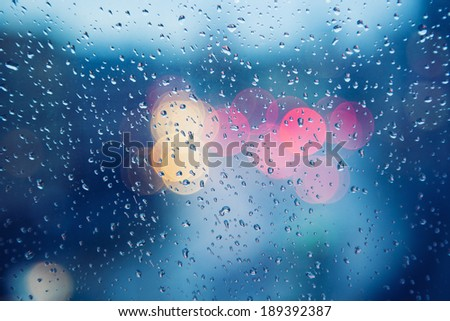 Rainy days,Rain drops on window,rainy weather,rain background,rain and bokeh - stock photo