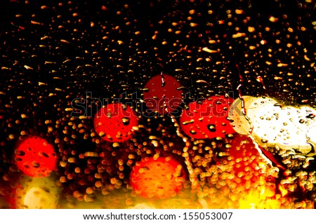 Rainy season  represented by wet Vehicle windshield - stock photo