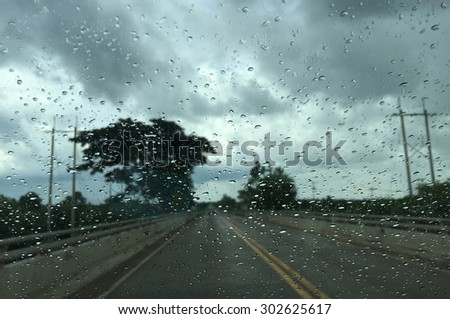 Rainy view from window car - stock photo