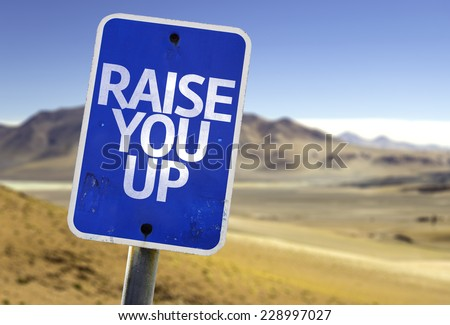 Raise You Up sign with a desert background - stock photo