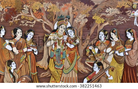 Raised crafted Indian Hindu Gods Krishna and Radha on wood, whole background - stock photo