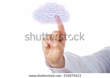 Raised right index finger of a business man is touching a swarm of virtual envelope icons that form a cloud computing symbol. Business metaphor for mobile E-mail access. Cutout on white. Close up. - stock photo