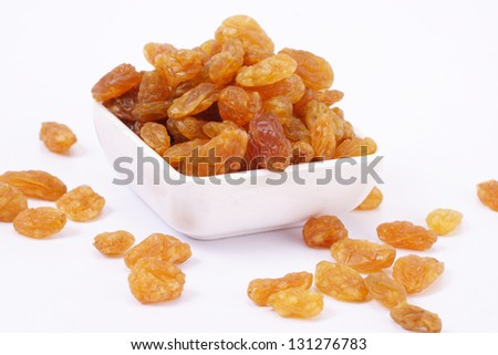 Raisins in a white bowl - stock photo