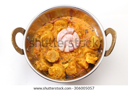 Rajasthani or Indian Gatta Curry or Gatte Ki Sabji or Gatte Ki Saag in a bowl isolated on white background. - stock photo